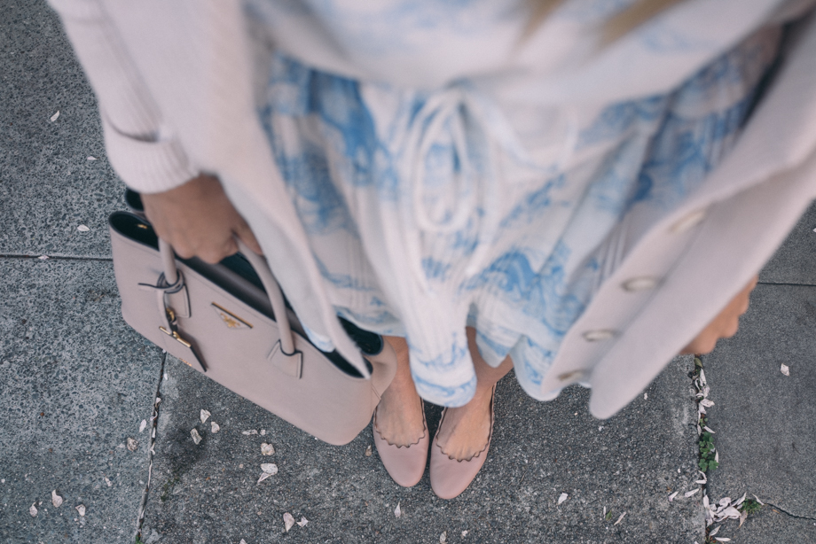 Julia from Gal Meets Glam pairs Chloe scalloped flats with a feminine look.